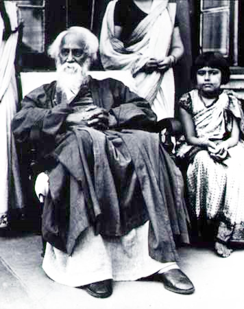 Rabindranath Tagore sitting with a child