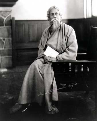 Rabindranath Tagore sitting with a book in hand